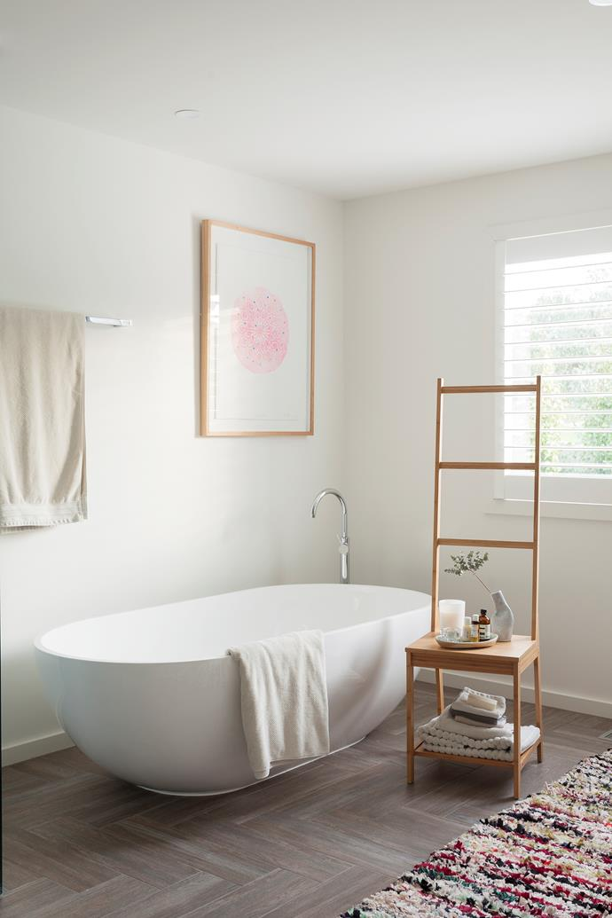 'Teresa' bath, from ACS Designer Bathrooms. Artwork, Lumiere Art + Co. Boucherouite runner, Tigmi Trading. Smart buy: 'Rågrund' bamboo towel-rack chair, $49, Ikea.