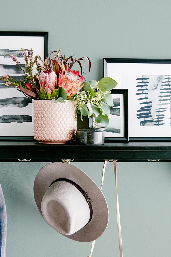 Why not paint a calming, sage feature wall to freshen up your home. Photo: Scott Hawkins