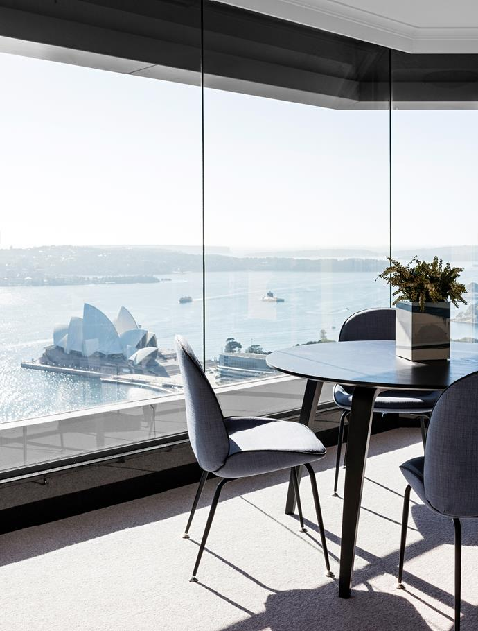 Breathtaking views in the dining area that is furnished with Gubi 'Beetle' chairs.