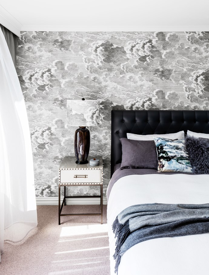 The sky view is echoed in the master bedroom by the wispy windblown clouds on the Cole & Son Fornasetti 'Nuvolette' wallpaper and lampshade fabric from Radford Furnishings.