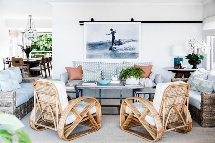 A trio of relaxed sofas is complemented by vintage French armchairs in Christopher Farr 'Brisa' fabric. Woven-frame sofas, John Himmel Decorative Arts. The sliding art display system, using 'A6' components from Centor, is a witty way to hang a surf-themed image.