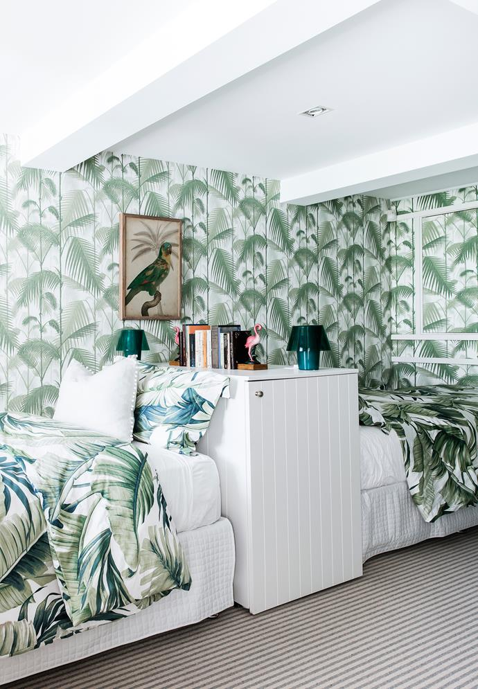 Head-to-head single beds make best use of the long, narrow room, given a vibrant look with retro prints and accents inspired by the mid-century Hotel Bel-Air in LA. Cole & Son 'Palm Jungle' wallpaper, from Radford.
