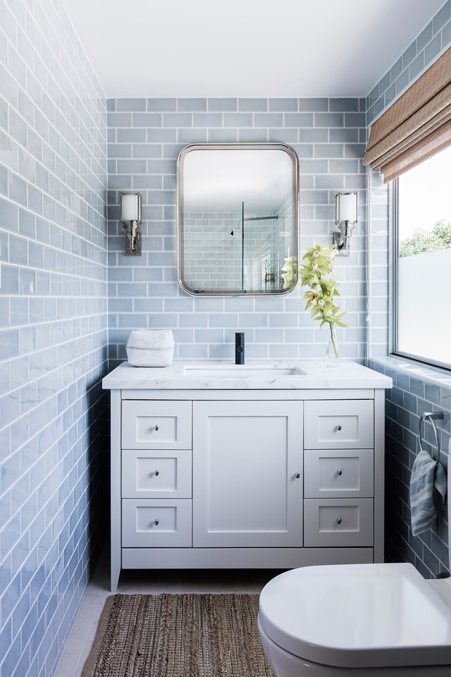 "Blue and white bathrooms have a fresh and timeless appeal, especially when styled with marble. This [beach front cottage in Pearl Beach](https://www.homestolove.com.au/beachfront-cottage-in-pearl-beach-nsw-6203|target=""_blank"") nails the look with cool blue, floor-to-ceiling subway tiles."