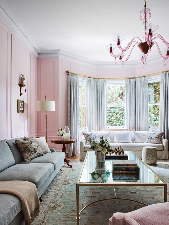"The powder pink walls of this grand living room in a [federation home](https://www.homestolove.com.au/sydney-north-shore-federation-home-6204|target=""_blank"") on Sydney's North Shore echo the Murano glass chandelier in spotted ruby and gold. ""This room is evocative of Audrey Hepburn in My Fair Lady, dressed in a pink chiffon gown,"" says the owner of the home, ""It's light, fresh, flowery and so pretty."""