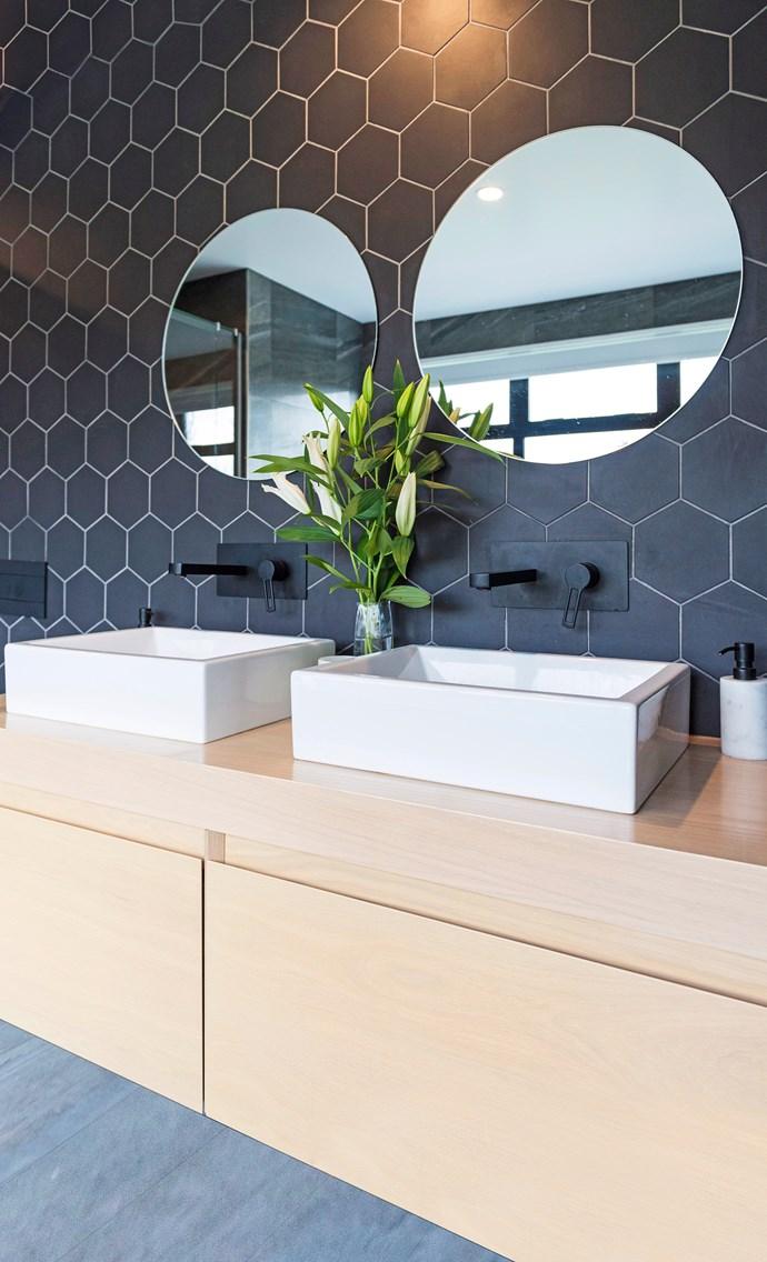 A matt black tiled splashback and taps make a striking statement.
