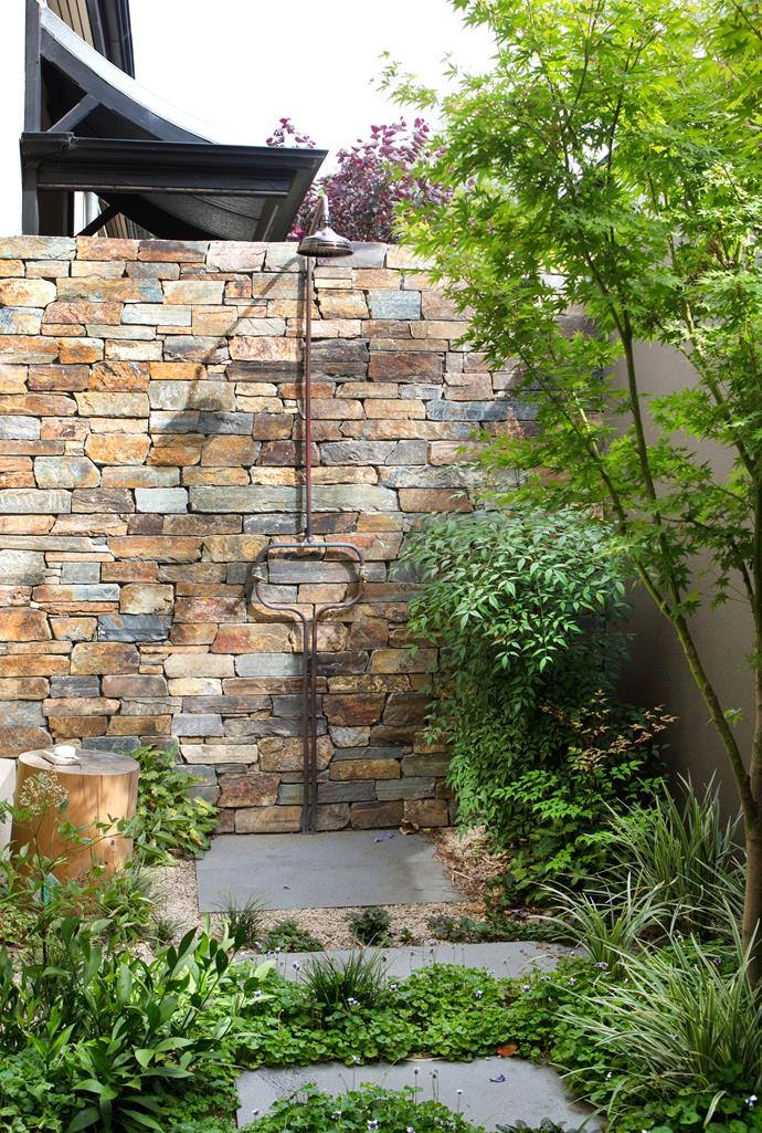 A Mark Tuckey timber pedestal in the outdoor shower.