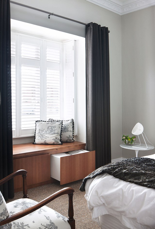 "This clever window seat in the main bedroom a [Federation home in Fitzroy](https://www.homestolove.com.au/federation-home-melbourne-fitzroy-modern-renovation-6216|target=""_blank"") not only provides a pleasant spot to sit but extra storage for pillows, throws or winter woolies. Photo: Sharyn Cairns"
