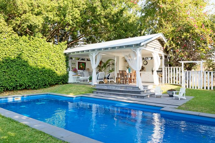 The Mediterranean blue of the fibreglass pool is a great contrast to the lush greens of the garden.
