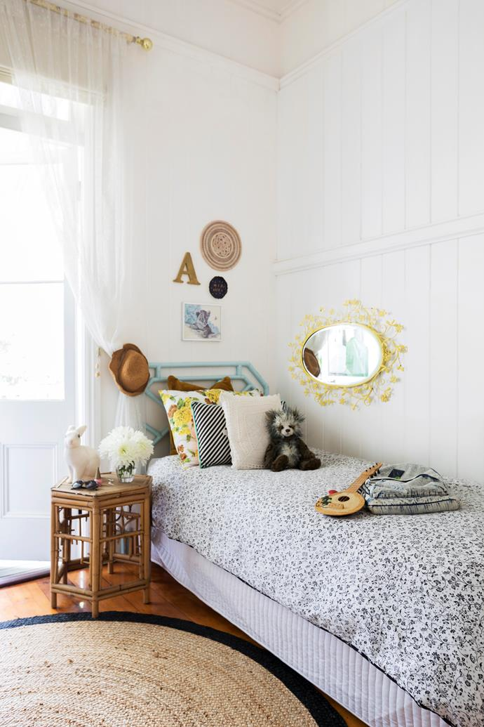Letters, prints and plates make an eclectic gallery wall.