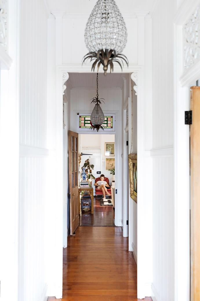 A long hallway welcomes visitors and stretches to the living room at the home's rear.