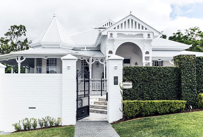 """[Neatly clipped hedges](https://www.homestolove.com.au/classic-queenslander-updated-for-family-living-2577