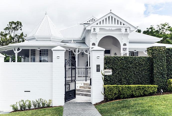 "[Neatly clipped hedges](https://www.homestolove.com.au/classic-queenslander-updated-for-family-living-2577|target=""_blank"") assist to balance out the intricate architectural elements of this heritage property. *Photography: Maree Homer*"