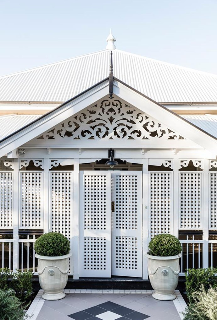 """Terracotta tiles, accented with [trimmed pot plants](https://www.homestolove.com.au/luxurious-renovation-of-an-old-timber-workers-cottage-5159