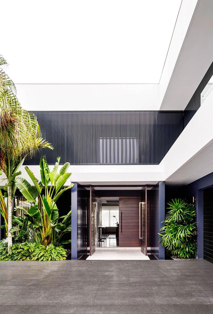 "Balconies and terraces, which are accented by palm trees and other greenery, wrap around this home in the [Gold Coast](https://www.homestolove.com.au/gold-coast-home-by-architect-bayden-goddard-4607|target=""_blank"") to further accentuate the crisp lines of Brazilian-style architecture. *Photography: Justin Alexander*"