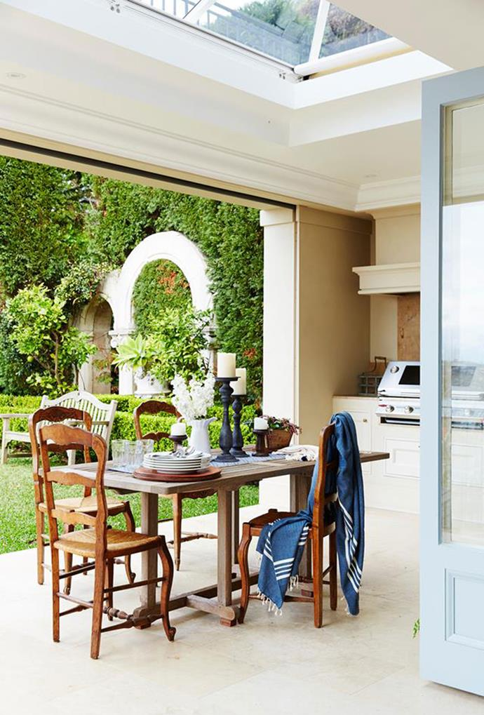 "Entertaining is the main focus in this [French-provincial paradise](https://www.homestolove.com.au/french-provincial-home-in-sydney-5418|target=""_blank""), located in Sydney's Eastern suburbs. Dinners usually take place in the lanai, where the retractable sun cover for the skylight and see-through screens prevent damage from wind, rain and insects. *Photography by John Paul Urizar*"