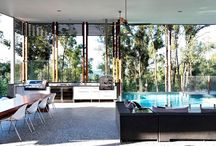 """Owners of this [Brisbane home](https://www.homestolove.com.au/6-outdoor-rooms-that-get-the-balance-right-1649 target=""""_blank"""") added a spacious outdoor room when they renovated that was designed to accommodate a big family. The alfresco kitchen and dining area adjoins the home's living areas and both the parents' and children's wings."""