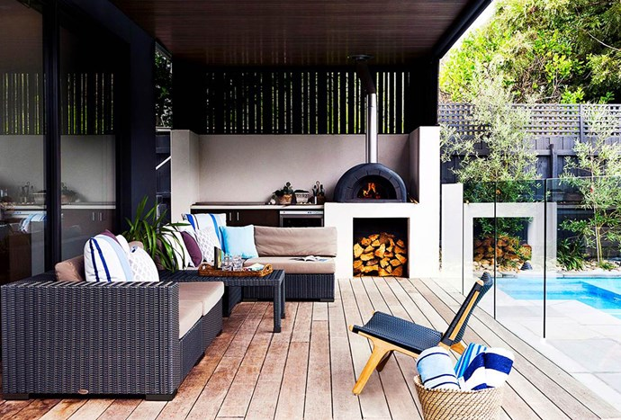 "Extra-wide merbau boards, ceiling cladding and wicker furniture pieces supplement the wood-fired oven and other kitchen essentials in this Melbourne [outdoor room](https://www.homestolove.com.au/6-outdoor-rooms-that-get-the-balance-right-1649|target=""_blank"")."