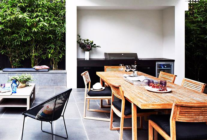 "An [outdoor wine fridge](https://www.homestolove.com.au/entertainment-ready-outdoor-areas-2741|target=""_blank"") and downlights that illuminate the barbecue and dining area take the hassle out of entertaining in this home. *Photography by Armelle Habib*"