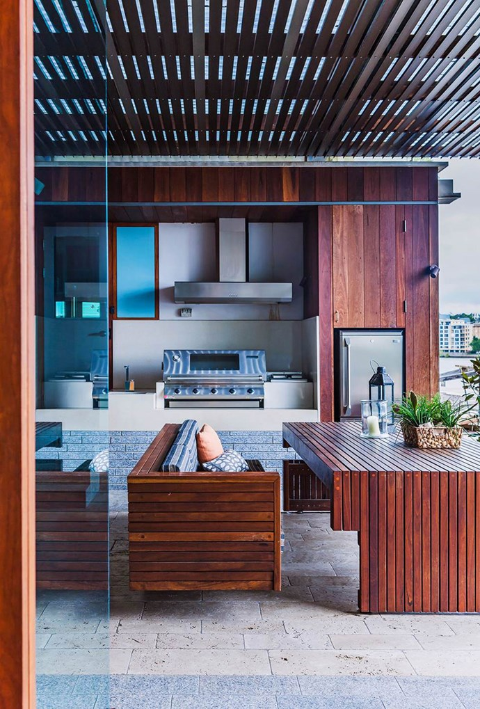 "A custom-made bench, matched to the shiplap cladding of this riverside home in [Brisbane](https://www.homestolove.com.au/eastern-aesthetic-inspires-new-build-in-brisbane-3805|target=""_blank"") complements the tropical-style alfresco space, whilst also remaining a practical outdoor area for a family of six. *Photography by Maree Homer*"