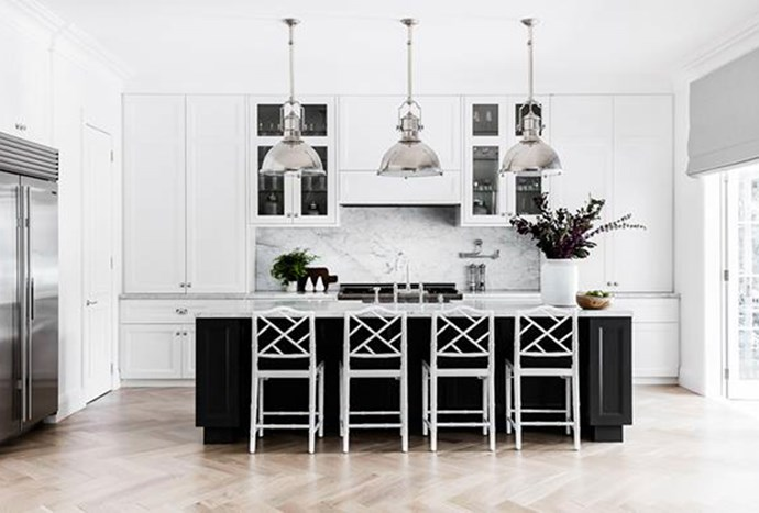 """Large [industrial pendants](https://www.homestolove.com.au/a-luxurious-hamptons-style-home-in-sydneys-eastern-suburbs-6074 target=""""_blank"""") in polished nickel, create a sense of order and symmetry in this elegant kitchen within Sydney' Eastern suburbs. *Photography by Maree Homer*"""