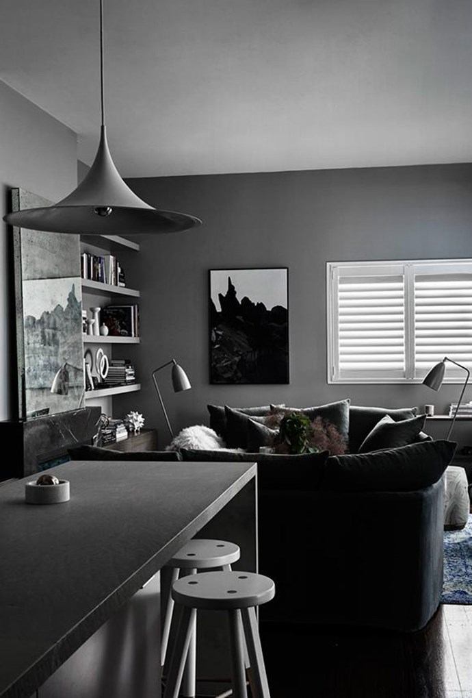 """Layers of finishes, textures, art and various pendant lights and floor lamps bring a sense of calm sensuousness to this [Melbourne home](https://www.homestolove.com.au/a-dark-and-sensuous-home-in-melbourne-5671 target=""""_blank""""). *Photography by Eve Wilson*"""