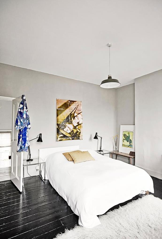 "A bedroom in this revamped [Victorian terrace](https://www.homestolove.com.au/a-victorian-terrace-with-vintage-scandi-style-4793|target=""_blank"") boasts a white palette, with simple decorating touches, such as art work and modern-style light pendants. *Photography by Birgitta Wolfgang Drejer*"