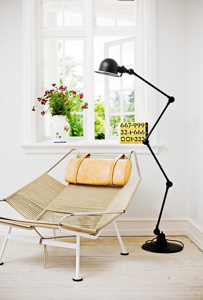 """A Jieldé floor lamp has been used to simply decorate a corner of the living area in this charming [country home](https://www.homestolove.com.au/an-all-white-home-with-colourful-accents-4789 target=""""_blank""""). *Photography by Morten Holtum*"""