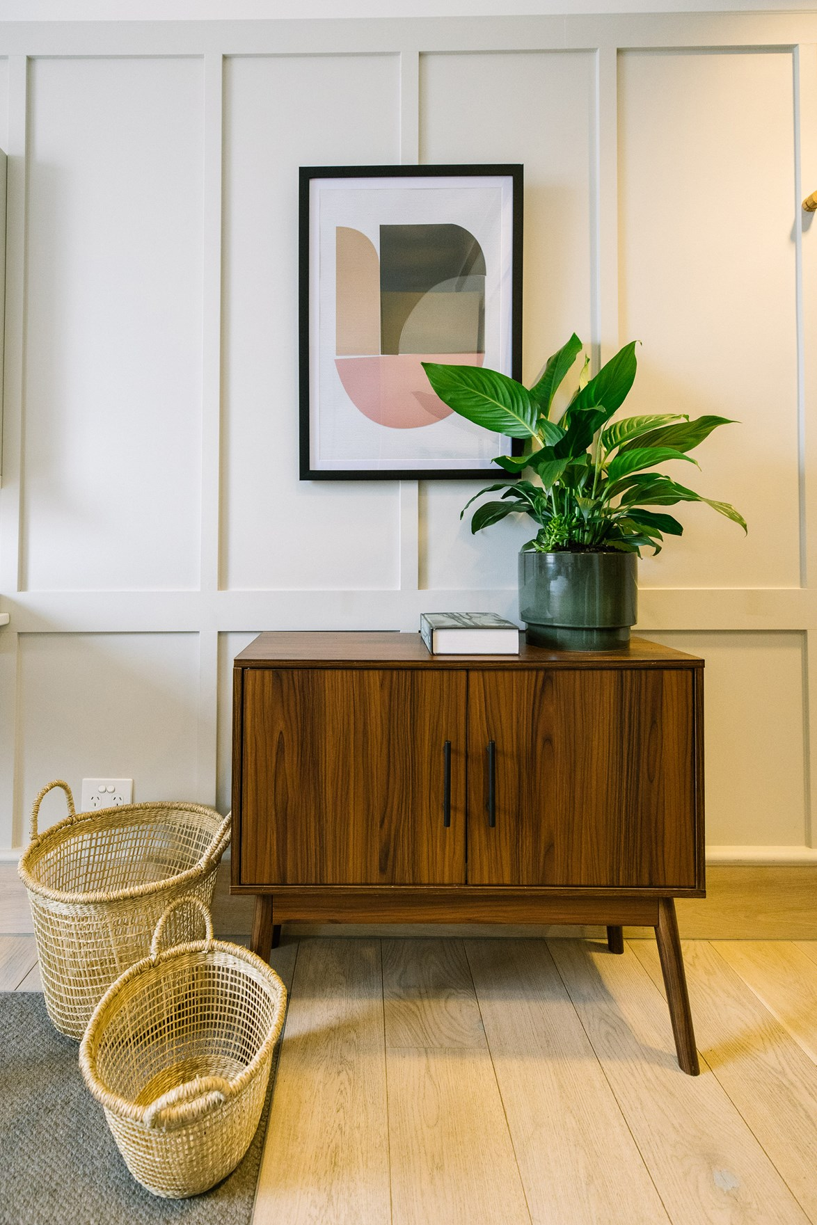 Kmart has embraced mid-century design with items like this Sideboard in a walnut finish, for just $45.