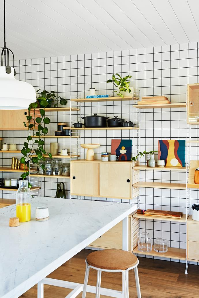 The Strings shelving system in the kitchen allows the family to keep their favourite items on display. The trinkets were sourced from David Bromley, Angelucci and local op-shops.