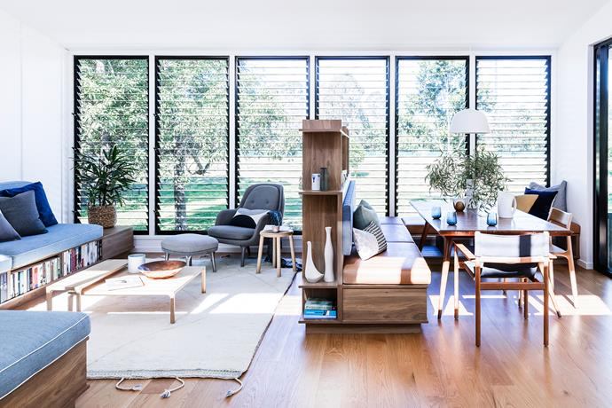 """""""You can look all the way from the front steps to the jacaranda tree in the back garden,"""" says Andrew. Shelves, gallery-like white walls and directional lighting create an ideal setting for books and art pieces."""