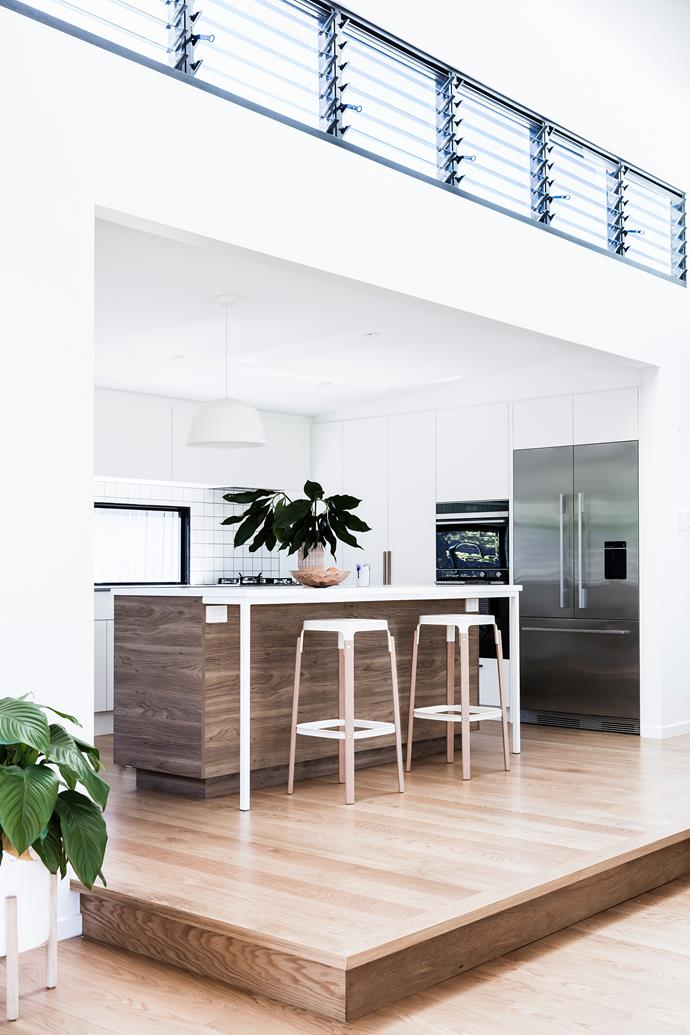In the old kitchen there wasn't even enough room for a dishwasher. The new layout in the extension has plenty of storage, workspace and comfortable seating under a bank of louvred windows. Polytec cabinetry in Classic White.
