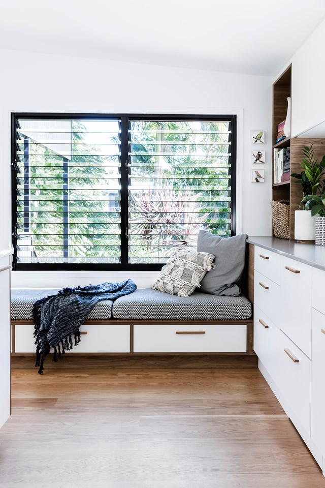 Custom-built, this window seat includes some much-needed storage, plenty of room to lay back and relax and the leafy outlook isn't bad either. Photo: Maree Homer