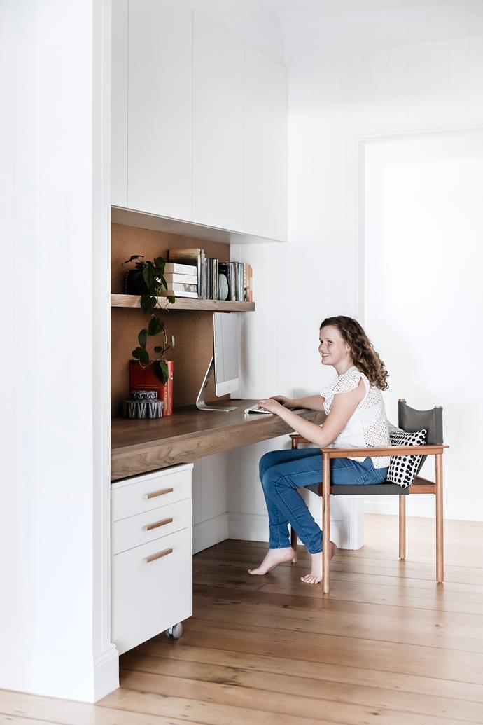 Rosie does her homework in the elegant, functional space. Evenex joinery in Tuscan Oak, Elton Group. 'Bilgola' chair, Cult.