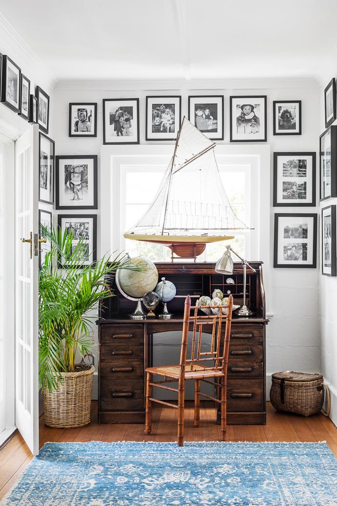 A roll-top design fits neatly into this alcove off the landing, surrounded by family photos. Globes, Adairs. The model boat was a present from Kate's mother.