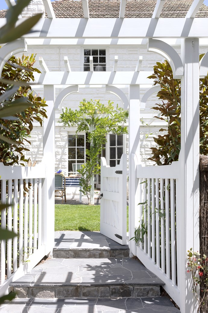 The new gate is sympathetic to the 1939 house. Always Greener Landscaping brought to life Kate's dream of a classic English garden.