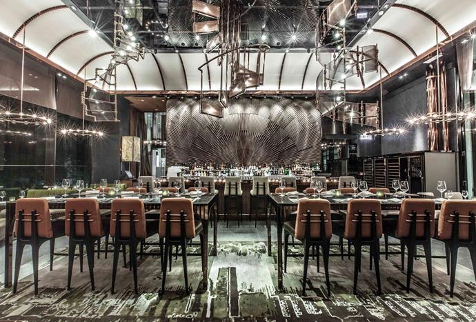 """**AMMO** <br><br> AMMO, a contemporary tapas bar and restaurant located in Honk Hong, uses hints of copper to create a luxurious, yet industrial interior that references the sites history and military past. *Photo via [AMMO](http://www.ammo.com.hk/