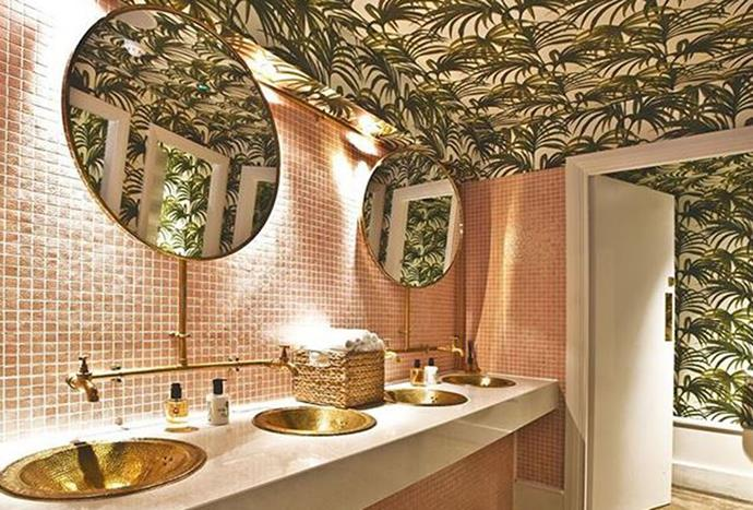 """**Restuarant Ours** <br><br> If you didn't already know, coloured bathroom tiles are going to be one of 2018's biggest trends. So, it's only fitting that Restaurant Ours in Los Angeles has combined a powdery pink tile with topical wallpaper that spans from the walls to the ceiling. *Photo via [@restaurant_ours](https://www.instagram.com/p/BHRqgatjTc6/?taken-by=restaurant_ours