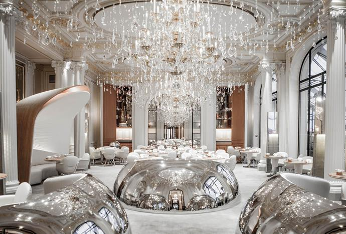 """**Alain Ducasse au Plaza Athenee** <br><br> Alain Ducasse au Plaza Athenee, a restaurant in Paris, has an elegant and sleek interior and was designed by a team of 20 architects, interior designers and product designers. Solid oak tables, along with large chandeliers and metallic plated seats create a sense of luxury. *Photo via [Alain Ducasse au Plaza Athenee](http://www.alain-ducasse.com/en/restaurant/alain-ducasse-au-plaza-athenee