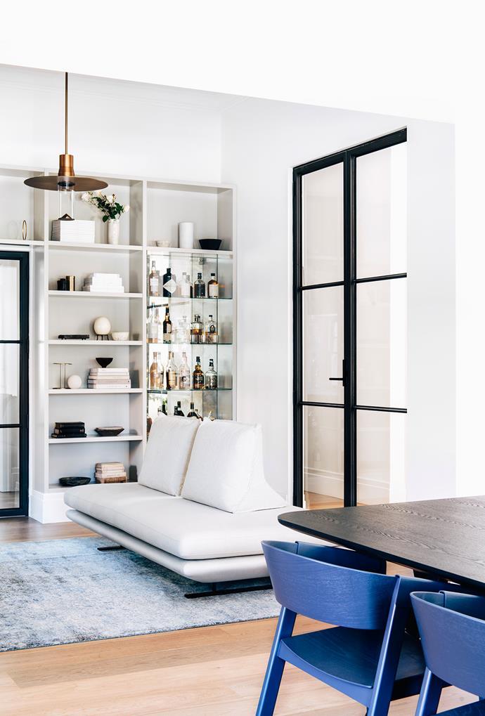 Steel-frame internal doors ensure peace and quiet. Cabinetry, Robson Rak. Ligne Roset 'Prado Settee', Domo. Rug, Loom Rugs.