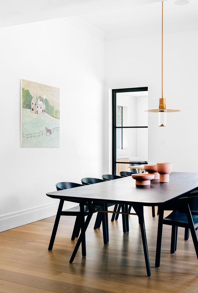 Oak flooring is a beautiful base for the contemporary furniture. 'Ren' table and Muuto 'Cover Chairs' from Living Edge. Pendant light, Viabizzuno Australia. Ceramics, Chris Connell Design. Artwork by Noel McKenna.Smart buy: 'Soho' French oak floorboards, $143/m² (supply only), Aged Oak Wide Floors.