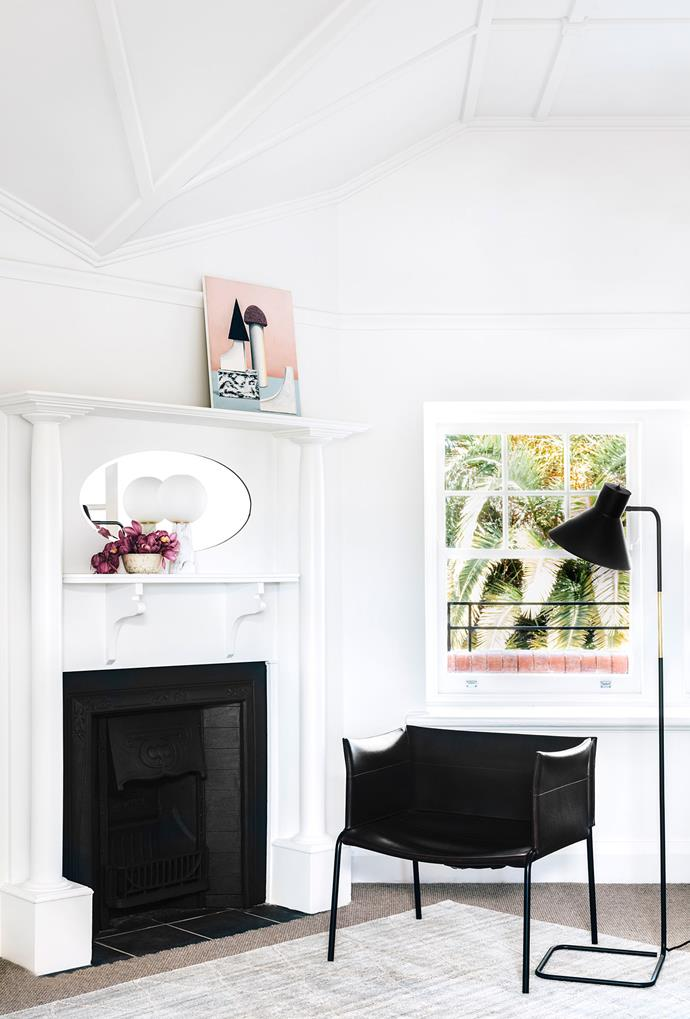 Two layers underfoot make this a cosy space. Chair, Chris Connell Design. Lamp, Curious Grace. Rug, Loom Rugs. Artwork by Sean Meilak.