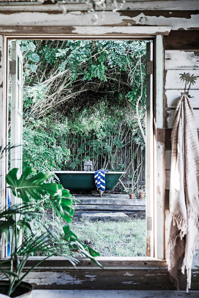 """""""Half the fun of doing up our little beach shack was sourcing old materials to maintain the relaxed feel,"""" adds Sonya, who used reclaimed wood from salvage yards for the window frames and picked up an outdoor bath on eBay."""