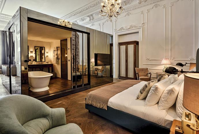 "**Soho House, Istanbull** <br><br> With double-height ceilings, a super king-size bed with Egyptian cotton sheets, a makeup table, a fireplace and open bathroom in the centre of the room, Soho House in Istanbul is the epitome of luxury. *Photo: [Soho House](https://www.sohohouseistanbul.com/en/hotel/the-playroom |target=""_blank"")*"