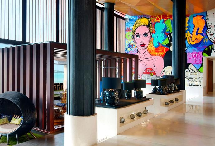 "**W Koh Samui, Thailand** <br><br> Pictured above is the electric lounge of the W Koh Sumai, featuring panoramic views of the island, outsized lamps, inviting lounges, daybeds and a contemporary artwork that is painted onto the main wall. *Photo: [W Koh Samui](http://www.wkohsamui.com/w-lounge |target=""_blank"")*"