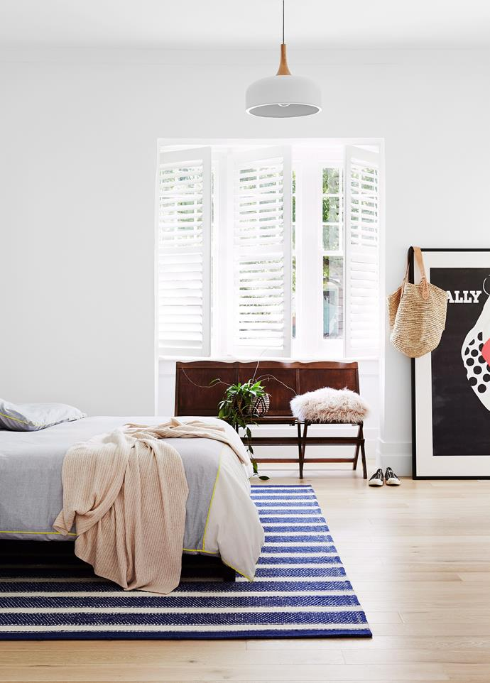 Classic plantation shutters create an architectural feature of the bay window in this light-filled bedroom as well as providing privacy. Photo: Annette O'Brien / bauersyndication.com.au
