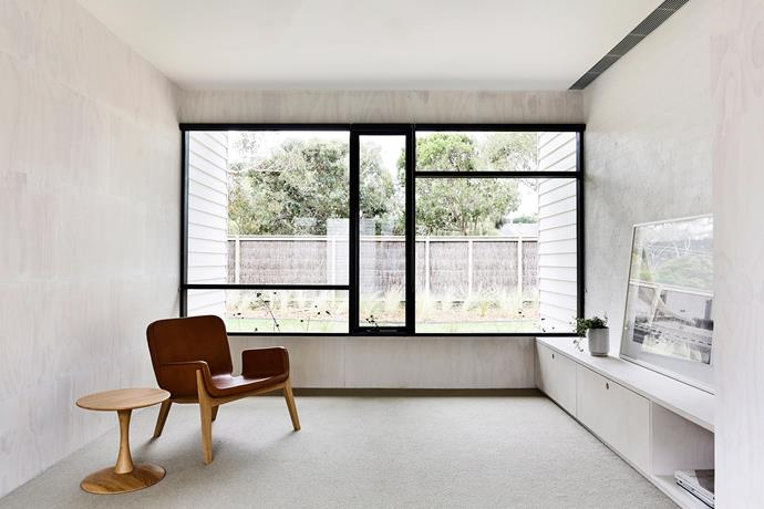 Filling the home with natural light and inviting the outdoors in, these large steel-framed picture windows create an overwhelming sense of space and openness in this minimalist abode. Photo: Derek Swalwell / bauersyndication.com.au