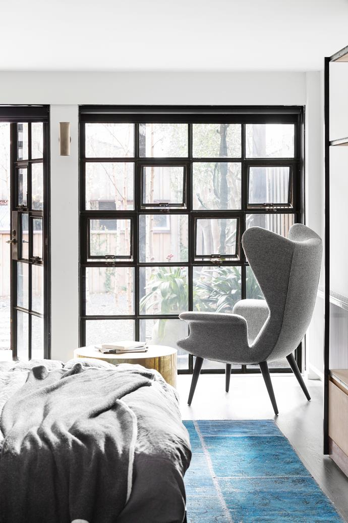 A design feature in its own right, a wall of casement-style windows creates much needed light in this basement-level bedroom as well as an eye-catching display. Photo: Martina Gemmola / bauersyndication.com.au