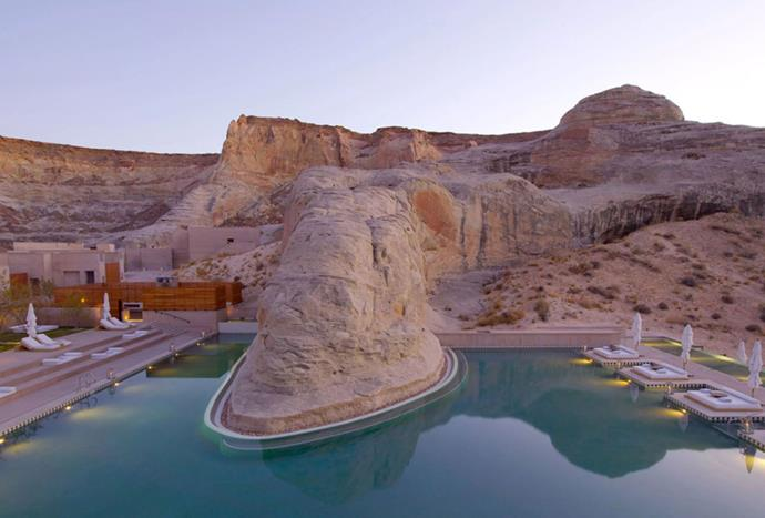 "**Amangiri, Utah** <br><br> Amangiri is a remote hideaway tucked within the canyons of the American Southwest. The suites frame the surrounding dunes, plateaus and mountain ridges, embracing the area's raw aesthetic. The interior is minimal and neutral, featuring wood furnishings. *Photo: [Amangiri](https://www.aman.com/resorts/amangiri|target=""_blank"")*"