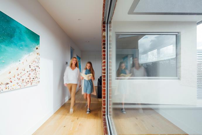 A entire wall of Viridian LightBridge™ double glazing opens up this narrow hallway, increasing natural light and enhancing the feeling of space.