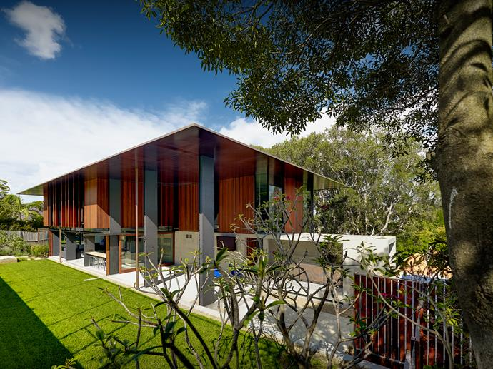 The pitched roof profile of the Land House in Mosman, and its timber shutters which allow for selective views.